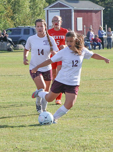 Tatiana Heggestad gets back up from sister Yulia as they work towards the Dexter goal. Photo by Anne Berleant