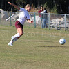Mariah Reinke races to keep the ball in bounds. Photo by Anne Berleant