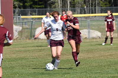 Mazie Smallidge tries to maintain control of the ball.  Photo by Franklin Brown