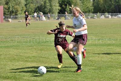 Junior Nellie Haldane rushes in against the Washington Academy Raiders interception.  Photo by Franklin Brown