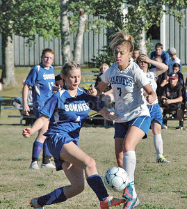Mariner RIley Getto fights to control the ball against Searsport. Photo by Jack Scogtt