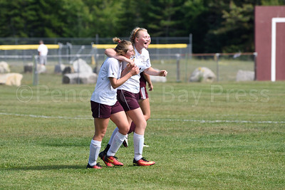 GSA Player Nellie Haldane celebrates with player Isla Brownlow as Brownlow scores the third goal for GSA.  Photo by Franklin Brown