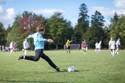 Goalie Alec Witham kicks against Washington Academy. Photo by Tate Yoder