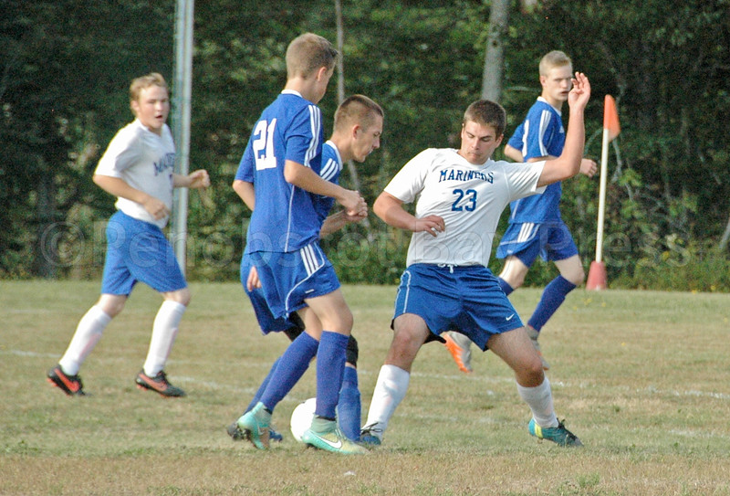 Mariner Nathan Winchester fights for the ball against Searsport. Photo by Jack Scott