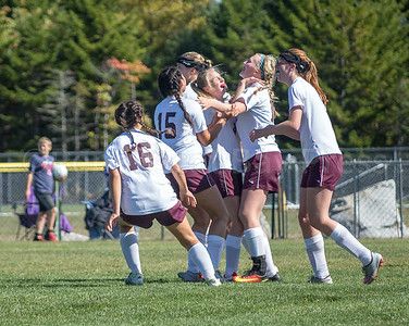 The Eagles varsity girls celebrate a hard-fought 2-2 tie against Bucksport on homecoming Saturday, September 24, for a 5-0-1 mid-season record.  Photo by Tate Yoder