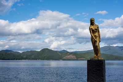 The statue of Tatsuko at the shore of Tazawako, Japan's deepest lake, Akita-ken.