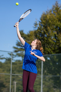 Eagle Madison Eaton reaches for the return against Deer Isle-Stonington. Photo by Tate Yoder