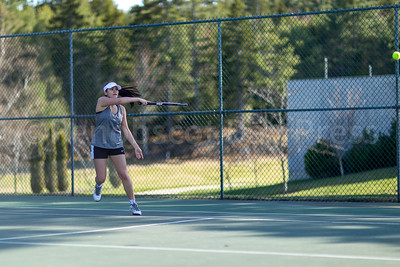 Eagle Julianna Allen swings a return against Deer Isle-Stonington. Photo by Tate Yoder
