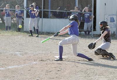 Katie Hutchinson pounds out a tirple against Bangor Christian. Photo by Jack Scott