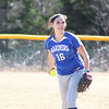 Abby Stinson warms up her pitching arm on the Deer Isle-Stonington softball field. Photo by Anne Berleant