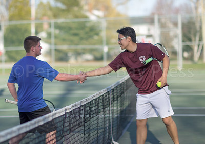 Mariner Devin Emrick and Eagle Kent Fang end their match. Photo by Tate Yoder