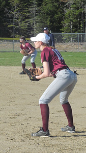 Senior Hannah Peasley holds down first base against Washington Academy. Photo by Anne Berleant