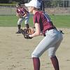 Senior Hannah Peasley holds down first base against Washington Academy. Photo by Anne Berleant