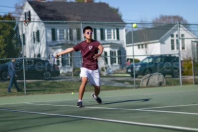 Boris Chen swings a forehand. Photo by Tate Yoder