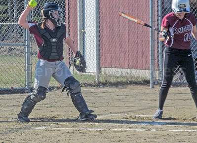 Senior Sarah Mullen returns a pitch. Photo by Anne Berleant