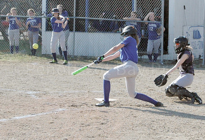 Katie Hutchinson pounds out a tirple against Bangor Christian. Photo by Jack Scott