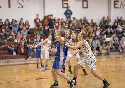 Morgan Dauk, shown pushing through the Searsport defense, will lead the Lady Eagles in the Class C tournament. Photo by Tate Yoder