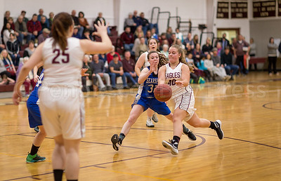 Emma Crosby releases a pass to teammate Josie Clark. Photo by Tate Yoder