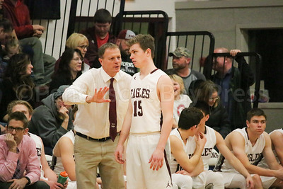 Coach Dwayne Carter directs Taylor Schildroth. Photo by Anne Berleant