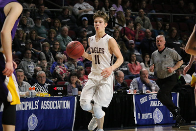 Caden Mattson moves the ball down court. Photo by Anne Berleant