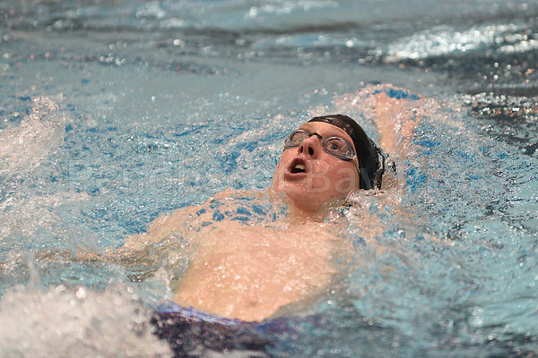 Jeremiah Scheff swims the 200 yard medley at the state championship in Orono. Photo by Franklin Brown