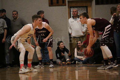 George Steven's Taylor Schildroth and Ellsworth's Bryce Harmon face off. Photo by Anne Berleant