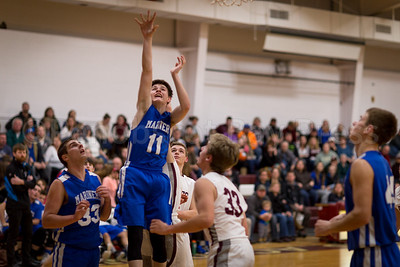 Ethan Bates-Cole quickly gets the shot off after the rebound. Photo by Tate Yoder