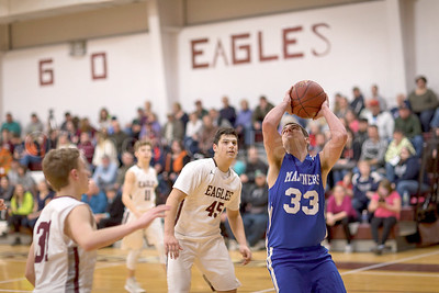 Nathan Winchester powers up for the basket. Photo by Tate YOder