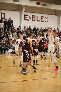 Taylor Schildroth carves space to shoot a three-pointer against Ellswroth. Photo by Anne Berleant