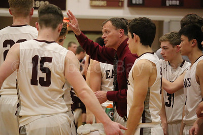 Coach Dwayne Carter works his team. Photo by Anne Berleant