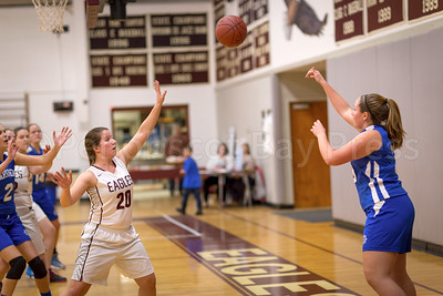 Mariner Madison Frazier passes over Yulia Heggestad in the final seconds of the game. Photo by Tate Yoder