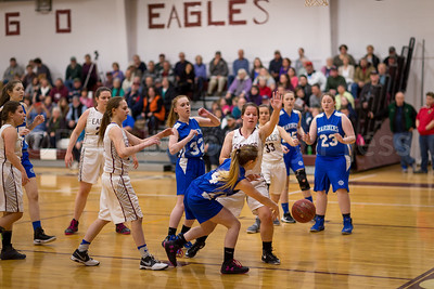 The Mariners and Eagles scramble at the net. Photo by Tate Yoder