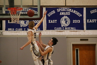 Max Mattson gets ready to slam an Ellsworth shot off the court. Photo by Anne Berleant