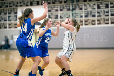 Katie Hutchinson and Brienna Limeburner double team Emma Crosby. Photo by Tate Yoder