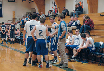 The Mariners and Coach Rufus Nicoll get ready return to the court against Greenville. Photo by Jack Scott