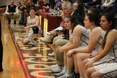 Coach Bill Case watches the action from the bench. Photo by Anne Berleant