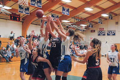 The Mariner girls stretch for the rebound against Bangor Christian. Photo by jack Scott