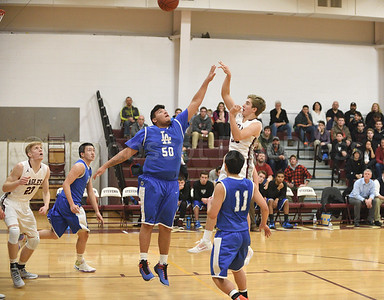 Percy Zentz steps back and shoots over the Lee Academy defense. Photo by Franklin Brown