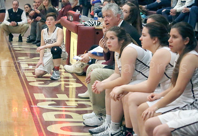 Coach Bill Case watches from the bench at the last Lady Eagles home game against Ellsworth on January 9. Photo by Anne Berleant