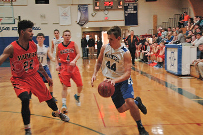 Mason Oliver drives the offense as the Mariners face Machias. Photo by Jack Scott