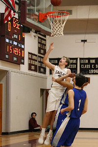 Percy Zentz makes an impact against Searsport. Photo by Anne Berleant