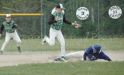 Silas Bates slides onto base  during a May 22 win against Schenck. Photo by Jack Scott