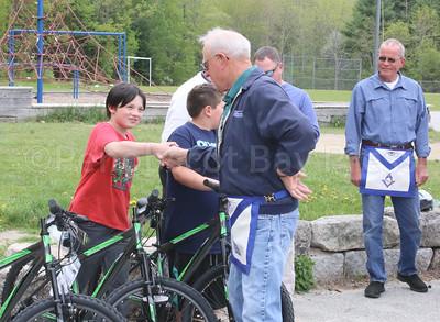 WP_BHCS_bikes_for_books_handshake__052517_AB