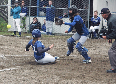 Brienna Limeburner slides home in a game against Jonesport. Photo by Jack Scott