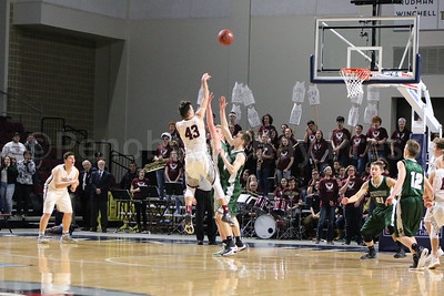 Jarrod Chase shoots from beyond the three-point line. Photo by Anne Berleant
