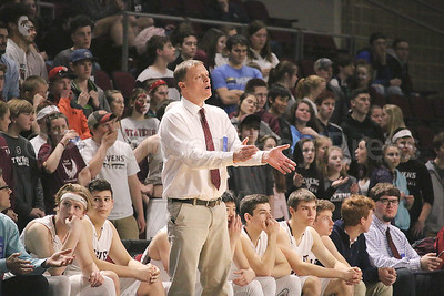 Coach Dwayne Carter endures a tight first three quarters. Photo by Anne Berleant