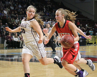 Emma Crosby works to defend. Photo by Anne Berleant