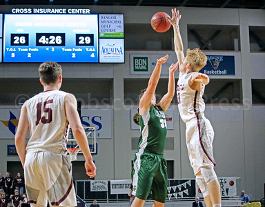 Max Mattson blocks a shot. Photo by Anne Berleant