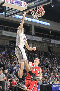 Jarrod Chase dunks. Photo by Anne Berleant