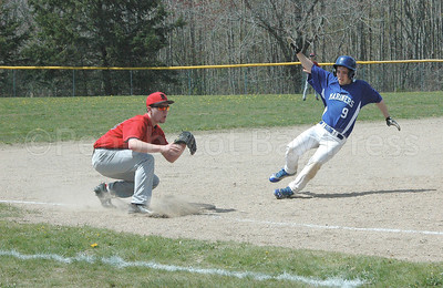 Silas Bates slides home against Katahdin. Photo by Jack Scott